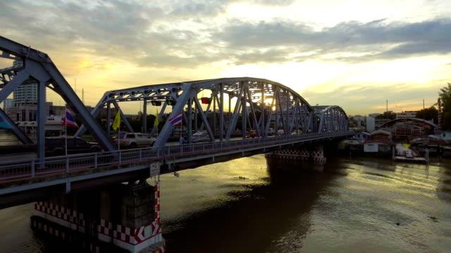 Steel Bridge across River at Morning with Golden Sky.