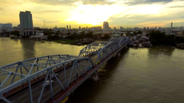Steel Bridge across River at Morning with Golden Sky.