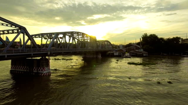 Steel Bridge across River at Morning with Golden Sky. video
