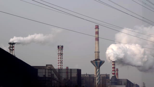 Steel factory is producing, chimney emissions. video