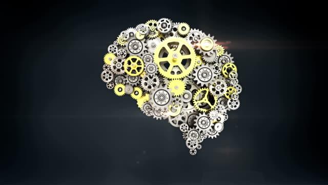 vidéos et rushes de engrenages d'or en acier faisant la forme humaine de cerveau. l'intelligence artificielle humaine. - equipement médical