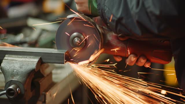 Steel Industry - Man using Angle Grinder Grinding Metal Object. Steel Industry - angle grinder grinding metal power tool stock videos & royalty-free footage