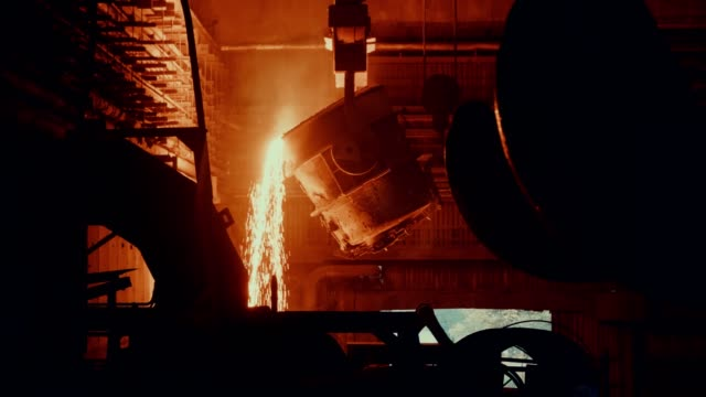 Steel mill factory - molten metal in vat Steel mill factory - molten metal in vat metallurgy stock videos & royalty-free footage