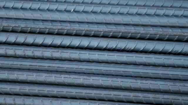 steel rods or bars used to reinforce concrete for construction - spranga video stock e b–roll