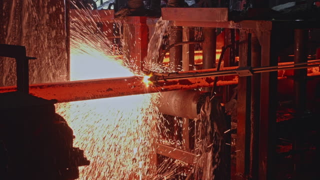 Steel Worker Manually Cutting the Steel Billets using a Gas Cutter Steel, Factory, Business, Industry, Africa, Part of a Series - Steel Billets Being Manually Cut Using a Gas Cutter by a Steel Worker iron metal stock videos & royalty-free footage