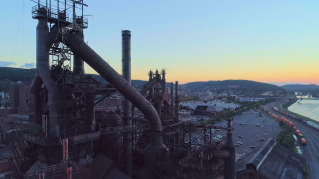 steelstacks - the historic steel plant converted into the modern cultural center in bethlehem, pennsylvania. aerial drone video with the orbit camera motion. - industria metallurgica video stock e b–roll