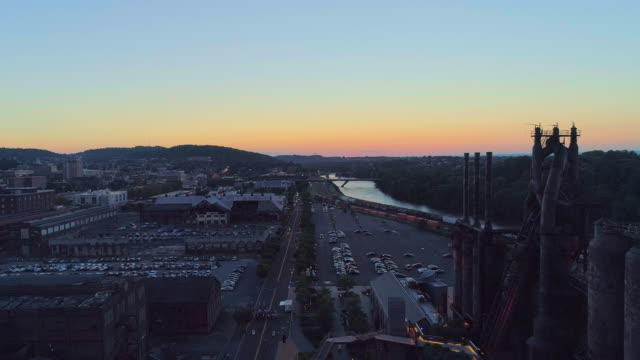 SteelStacks - the historic steel plant converted into the modern cultural center in Bethlehem, Pennsylvania. Aerial drone video with the forward camera motion. Historic steel mill in Bethlehem, Pennsylvania. 4K UHD aerial drone video footage. steel mill stock videos & royalty-free footage