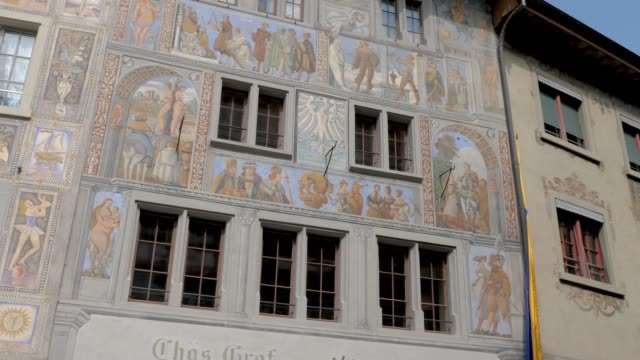 Stein am Rhein- House of the white eagle and pedestrian street House of the white eagle (German: Haus zum Weissen Adler) from 1520. Camera pans left across the facade with fresco. bay window stock videos & royalty-free footage