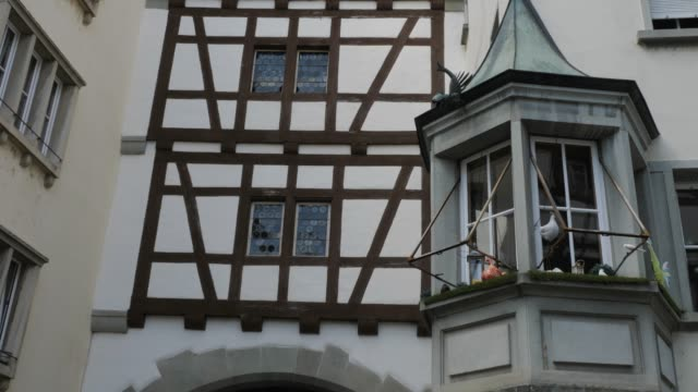 Stein am Rhein lower city gate- tilt down Camera shot starts at top of the lower city gate, tilts down to entrance, and then pans left down a small street (Choligasse). bay window stock videos & royalty-free footage