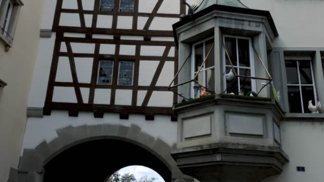 Stein am Rhein lower city gate- tilt up Camera shot starts at entrance of the lower city gate and tilts up. bay window stock videos & royalty-free footage