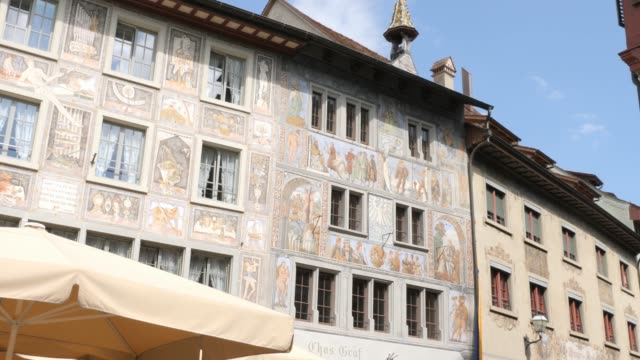 Stein am Rhein marketplace and town hall- pan right Camera pans right from Haus zum Weissen Adler- House of the white eagle, to the town hall of Stein am Rhein. bay window stock videos & royalty-free footage