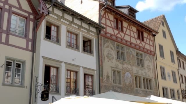 Stein am Rhein- painted houses and pedestrian street Camera pans right from houses on one side of the pedestrian street to the other side. bay window stock videos & royalty-free footage