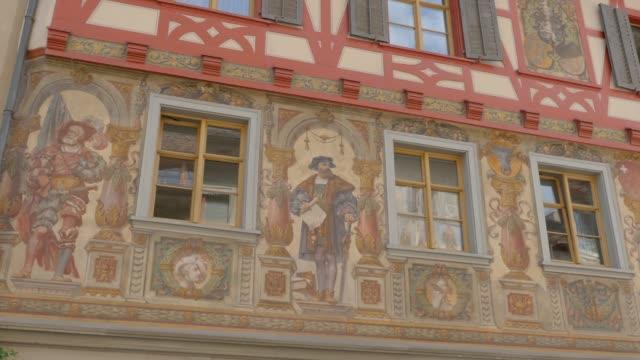Stein am Rhein- pan left building with fresco Stein am Rhein- pan left building with fresco Camera pans left to Haus zum Steinbock bay window stock videos & royalty-free footage