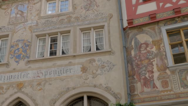 Stein am Rhein pedestrian street to market place Camera pans right down pedestrian street to market place, along the facades of painted houses. bay window stock videos & royalty-free footage