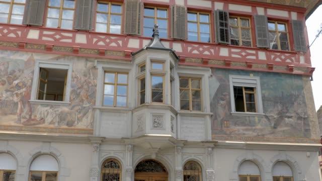 Stein am Rhein town hall building- tilt up Camera tilts up facade of town hall building in Stein am Rhein, Switzerland. bay window stock videos & royalty-free footage