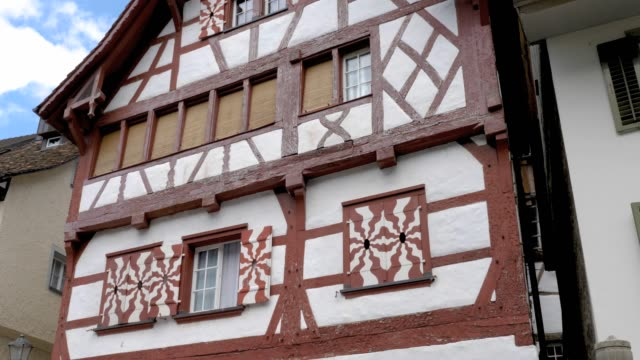 Stein am Rhein- traditional buildings in old town Camera pans right across the facades of medieval houses. bay window stock videos & royalty-free footage