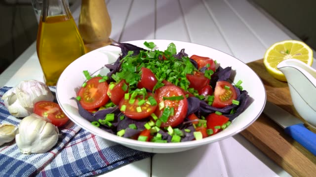 Step by step. Preparing mix salad with vegetables at home. Serie. Adding parsley . Step by step. Preparing mix salad with vegetables at home. A part of.  Adding parsley . parsley stock videos & royalty-free footage