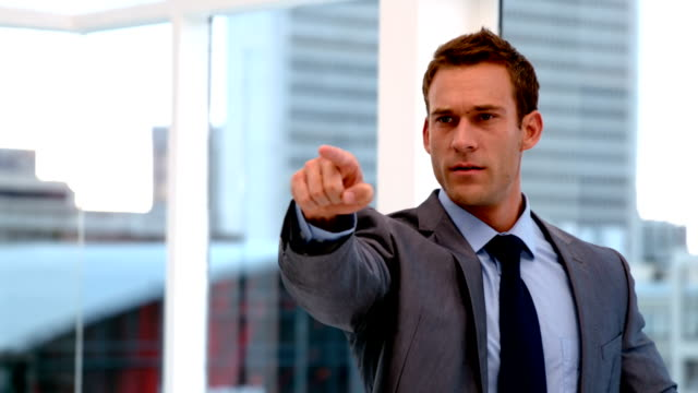 Stern handsome businessman pointing ahead video