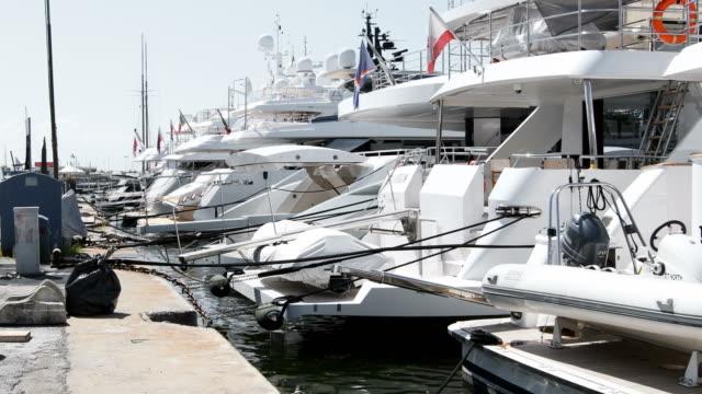 Stern of many luxury yachts