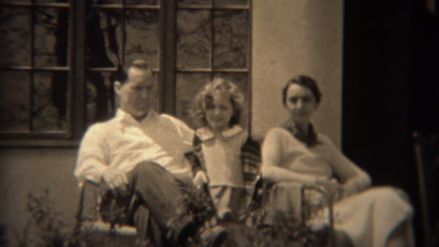 1937: Stern smileless father with curly haired daughter and timid mother. video