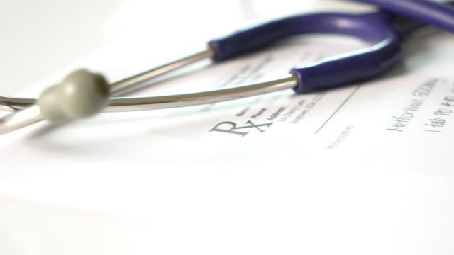 Stethoscope and drug prescription video