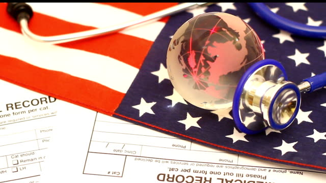 Stethoscope and globe on a USA flag video