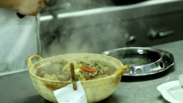 stewed chicken with chili pepper in dish video