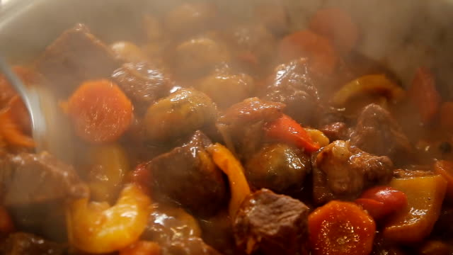 Stewing beef and vegetables goulash video