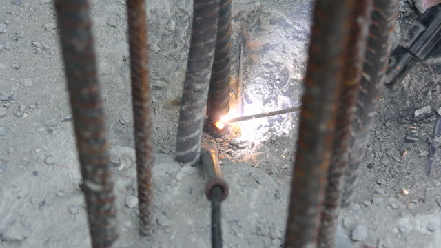 Stick Welding Metal. Electrodes for welding and sparks. Welder at work,Construction. stick plant part stock videos & royalty-free footage