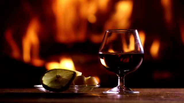 still life of a glass of brandy and plate with cheese and lemon - brandy video stock e b–roll