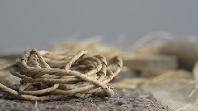 Still life of ropes, boards, burlap and hay in the old wooden table. video