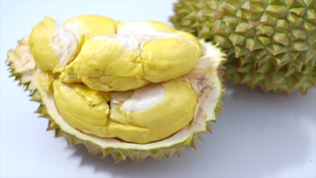 Still life photography of Durian the king of tropical fruits on white background with path, shooting in studio. Popular dessert in Thailand served with sticky rice and fresh coconut milk on topping.