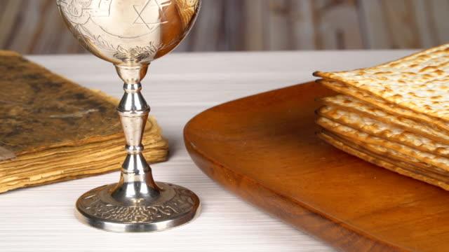Still-life with wine and matzoh (jewish passover bread) Jewish matza on Passover video