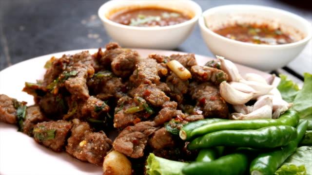 Stir fried beef salad eating, Traditional Thai food video