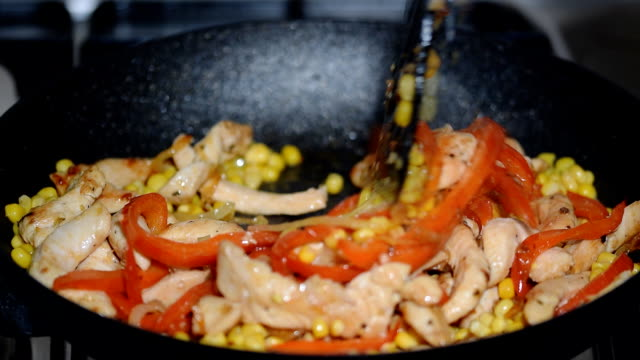 Stir fry chicken, sweet peppers and corns. Top view. Stir fry chicken, sweet peppers and corns. Top view. stir fried stock videos & royalty-free footage