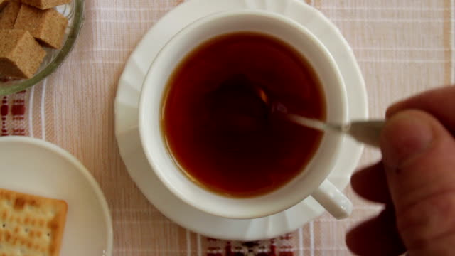 Stir sweet tea cup of hot tea overhead shot close to mug stock videos & royalty-free footage