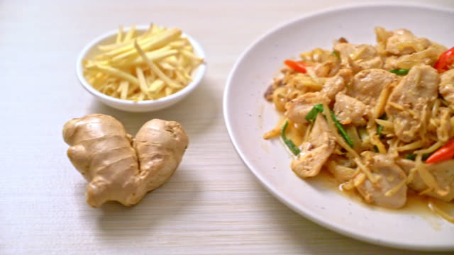 stir-fried chicken with ginger - asian food style - aglio cipolla isolated video stock e b–roll