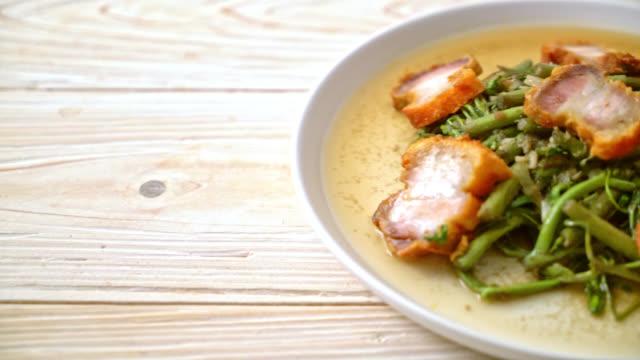 Stir-fried water mimosa with crispy pork belly