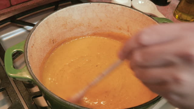 Stirring Butternut Squash Soup in a Green Dutch Oven in 4k video