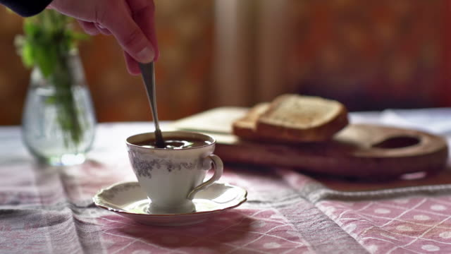 SLOW MOTION: Stirring Coffee Slow motion of stirring a cup of Coffe 笹 stock videos & royalty-free footage