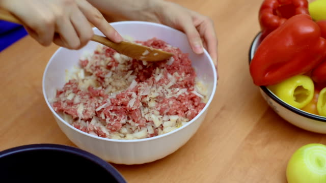 Stirring minced meat, chopped onions and rice Preparation of meat mixture for stuffing bell peppers stuffed stock videos & royalty-free footage