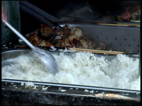 Stirring, Serving Steamed White Rice (put into Polystyrene Plastic container) video