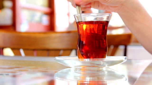 Stirring Tea in a clear glass video