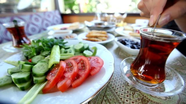 stirring Turkish tea at Turkish breakfast video