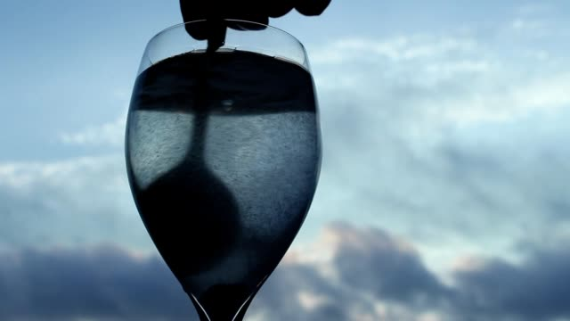 Stirring white powder in a glass of water video
