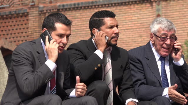 Stock Brokers Talking On Cell During Stock Market Panic video