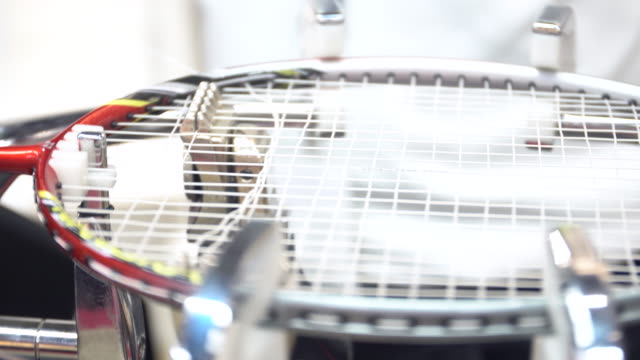 4k stock footage of man made weaving badminton racket, by auto machine - badminton stock videos & royalty-free footage