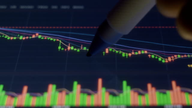 stock market data with digital tablet
