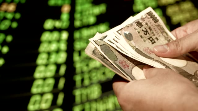 Stock market in my hand is a Japanese money communication marketing online, business man in the stock market office