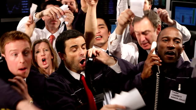 Stock Traders Crowd of financial traders in a Stock Exchange. Business people trading stocks and shares on an international scale. Trading currency, stocks and bonds. financial occupation stock videos & royalty-free footage